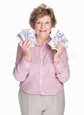 Buy stock photo Portrait of a happy elderly woman holding cash in hands on white background