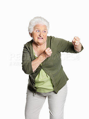 Buy stock photo Portrait of a mature woman in fighting gesture isolated against white background