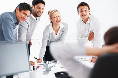Buy stock photo Group of successful business people looking at their leader and smiling