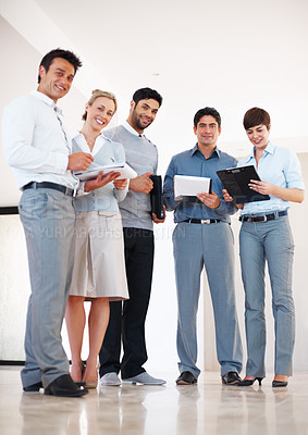 Buy stock photo Full length of successful business partners discussing in the corridor