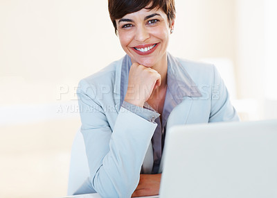 Buy stock photo Portrait of smiling business woman with hand on chin sitting at her desk