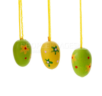 Buy stock photo Colored easter eggs hanging on threads isolated on white background