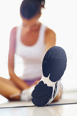 Buy stock photo Closeup of woman doing stretching exercise with focus on shoe