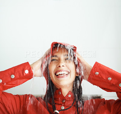 Buy stock photo Closeup portrait of young woman in raincoat enjoying the rain