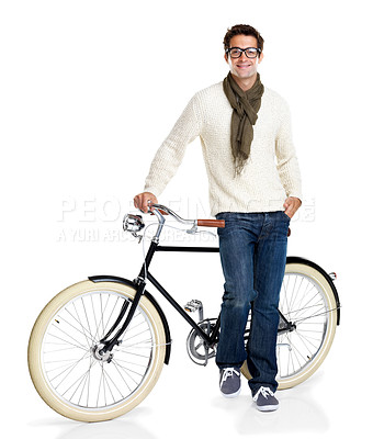 Buy stock photo Portrait of a happy young man standing with a vintage bicycle against a white background