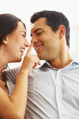 Buy stock photo Cheerful woman touching her boyfriend's nose