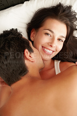 Buy stock photo Young couple getting intimate in bed