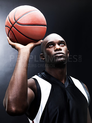 Buy stock photo Portrait of a muscular young man playing basketball against grunge background