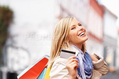 Buy stock photo Smiling attractive female with credit card and shopping bags