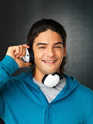 Buy stock photo Close up of man holding headphones