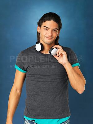 Buy stock photo Smiling man holding headphones