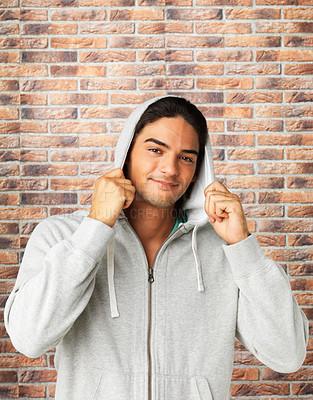 Buy stock photo Handsome man pulling on hood of sweatshirt