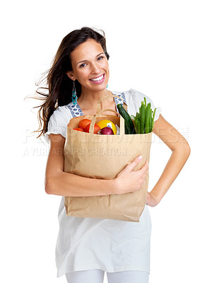 Buy stock photo Portrait of an attractive young woman holding vegetable bag on white background
