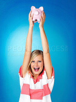 Buy stock photo Blonde woman holding up piggybank