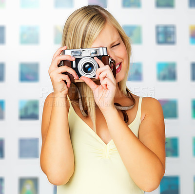 Buy stock photo Pretty woman taking a photo with vintage camera