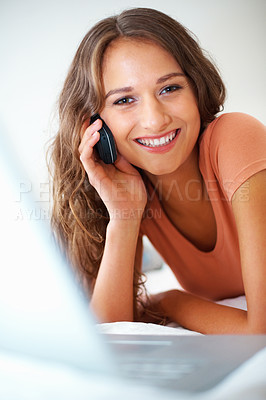 Buy stock photo Close up of girl on the phone with laptop in front of her