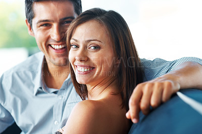 Buy stock photo Portrait of an attractive young couple smling together - Indoor