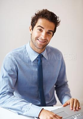 Buy stock photo Smiling business man working on laptop