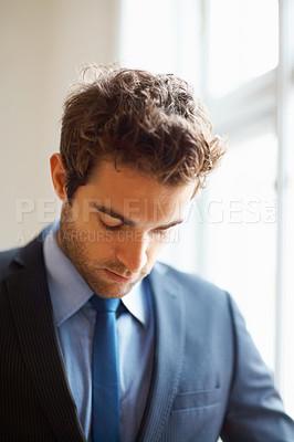 Buy stock photo Closeup of executive looking down
