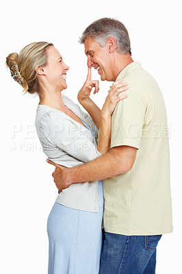 Buy stock photo Portrait of happy mature couple smiling over white background