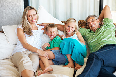 Buy stock photo Portrait of family spending time together at home