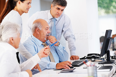 Buy stock photo Group of successful business people preparing presentation during meeting
