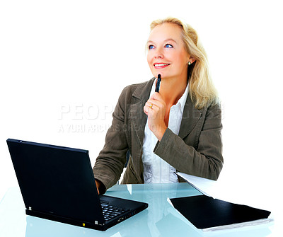 Buy stock photo Portrait of a thoughtful-looking businesswoman sitting in front of a laptop isolated on white