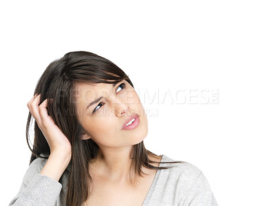 Buy stock photo Cute female scratching head in thought - Iisolated against white