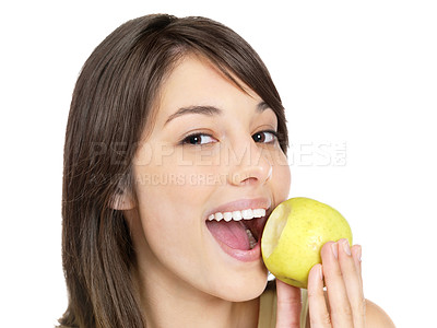 Buy stock photo Closeup portrait of a cute young female eating a green apple - Isolated against white