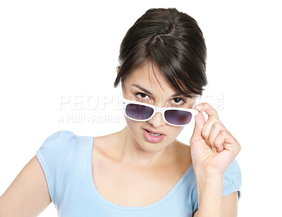 Buy stock photo Young casual female wearing sunglasses isolated against white