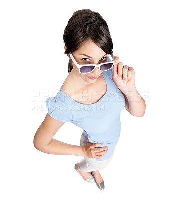 Buy stock photo Top view portrait of a cute young female wearing sunglasses isolated against white