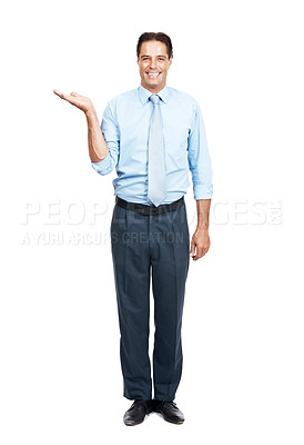 Buy stock photo Portrait of a businessman holding something in his hand against a white background