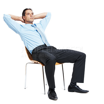 Buy stock photo Shot of a mature businessman sitting on a chair with his hands behind his head isolated on white
