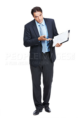Buy stock photo Portrait of a businessman gesturing towards a clipboard against a white background