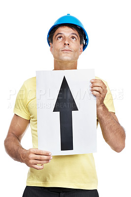 Buy stock photo Shot of a construction worker holding a sign with an arrow pointing up on it