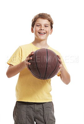 Buy stock photo Portrait of a happy small child standing with basketball against white background
