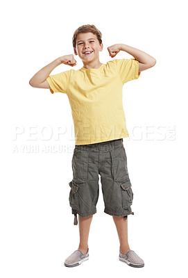 Buy stock photo Full length portrait of an innocent little boy flexing biceps isolated against white background
