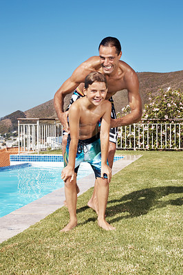 Buy stock photo Portrait of a joyful mature man playing with his small son by the swimming pool - Outoor