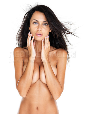 Buy stock photo Portrait of a naked young lady standing with hands covering her breasts, isolated on white