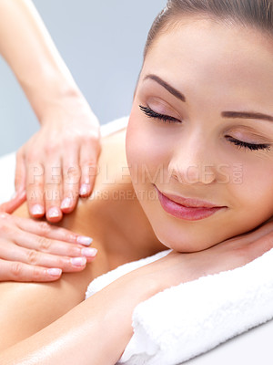 Buy stock photo Getting a massage - smiling face. Portrait of a pretty young woman getting a massage at the day spa