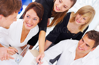 Buy stock photo High angle shot of a group of coworkers in a meeting