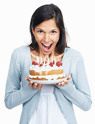 Surprised woman with cake