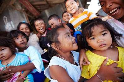 Buy stock photo A group of Thai children standing together outside