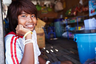 Buy stock photo A portrait of a smiling Thai girl sitting on the ground