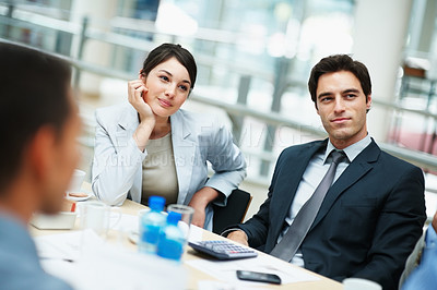 Buy stock photo Young executives sitting attentively at a business meeting