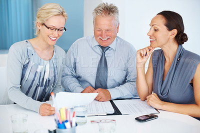 Buy stock photo Happy business man discussing with female colleagues in office