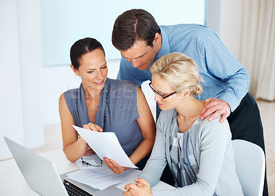 Buy stock photo Portrait of three good looking business people discussing together in office