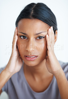 Buy stock photo Closeup of mixed race woman suffering from pounding headache
