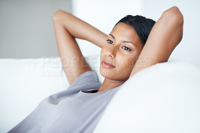 Buy stock photo Closeup of beautiful mixed race woman resting on her couch gazing into the distance in deep thought - copyspace