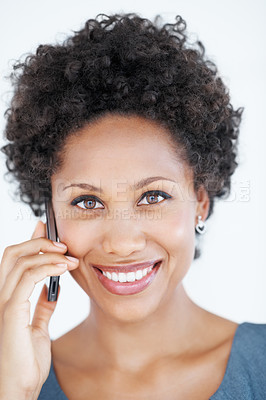 Buy stock photo Closeup portrait of attractive African American business woman talking on mobile phone over white background